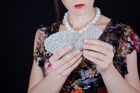 Gypsy woman predicts fate by holding cards in her hands photo