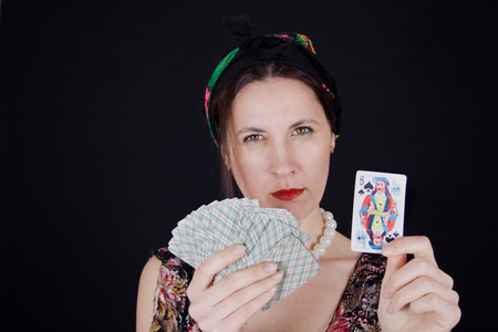 Woman with fortune-telling cards in her hands predicts fate