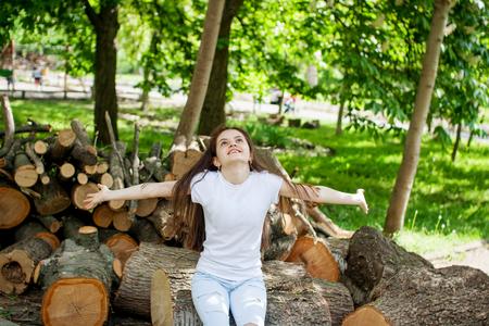 Beautiful girl enjoying the summer sun outdoors in the park.