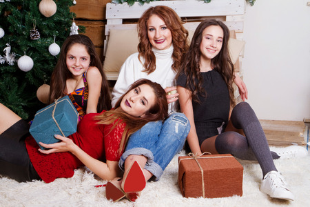 Christmas family gatherings around the Christmas tree with gifts photo