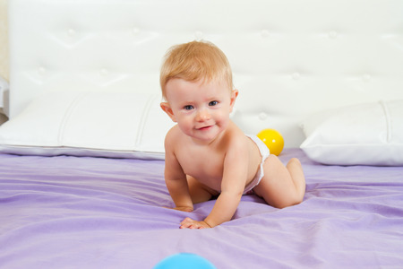 Cute laughing little baby enjoying her tummy time