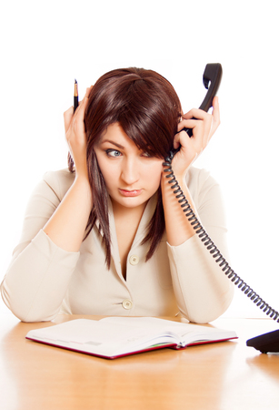 Girl Secretary works in the office, a lot of talking on the phone. hard work. unpleasant conversations Stock Photo