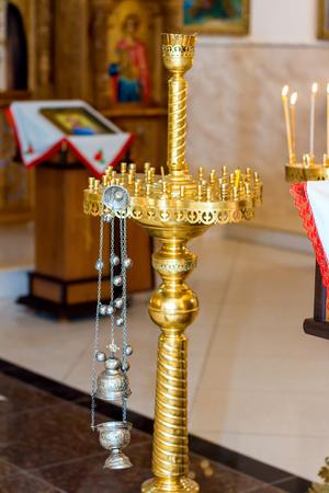 Burning candles in Christian church.Ortodox Church in Moldavian