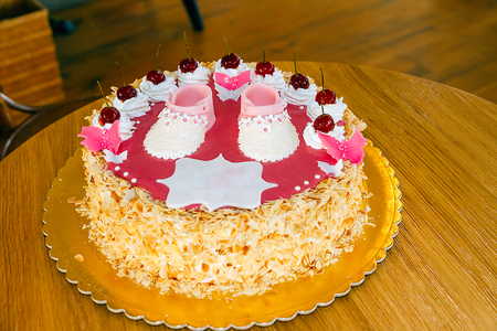 Decoration details of a birthday cake made for little baby girl, in pink and white. Stock Photo