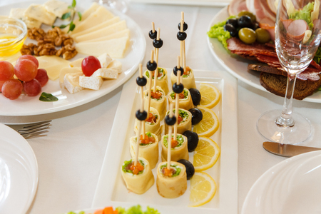 Delicious canapes for baby shower on plate Stock Photo