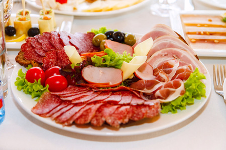 Meat sausage slices assortment on Party Plate, top view Stock Photo