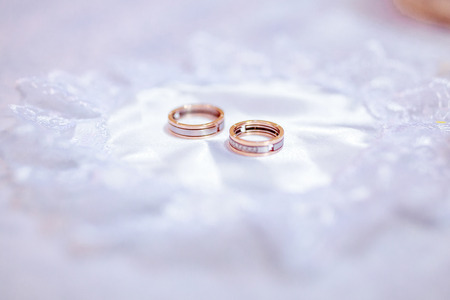 Close up of the wedding rings on bright background Stock Photo