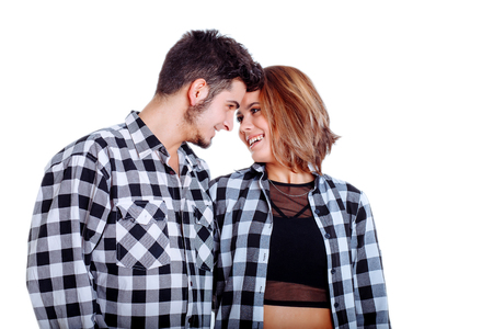 Full portrait of happy couple isolated on white background. Attractive men and women being playful.