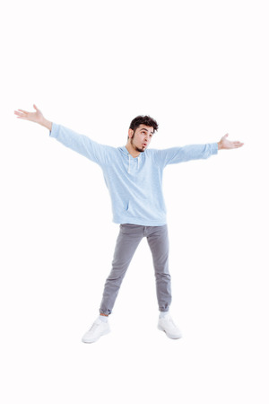 Portrait of a man gesturing freedom expression over white background