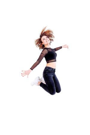 Sport woman jumping isolated on white background. Fitness and healthy lifestyle.