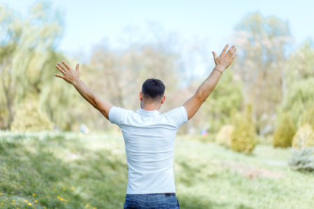 Happy man enjoying nature - freedom happiness concept