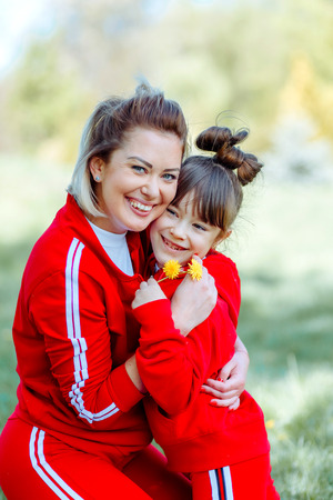 Smiling mother and little daughter on nature. Happy people outdoors 写真素材 - 123239687