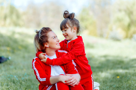 Portrait of mother and daughter playing in the park 写真素材