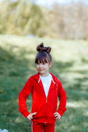 Portrait of the child playing in the park. 写真素材 - 123239696