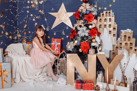 Portrait of a beautiful girl in the New Years holiday 写真素材