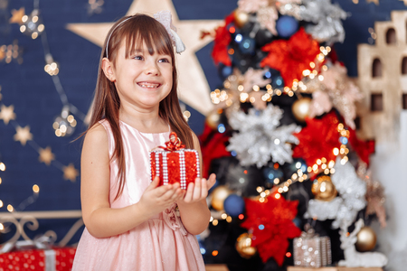 Christmas magic, girl with a gift on bokeh background 写真素材
