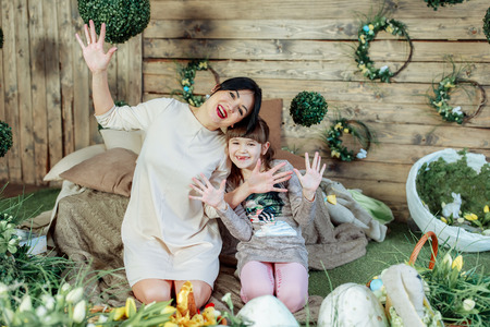 Beautiful mom and her cute daughter are hugging and smiling 写真素材 - 123278277