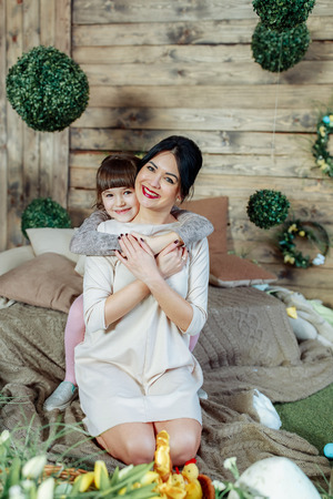 Daughter hugs mom and looks into camera 写真素材 - 123294677