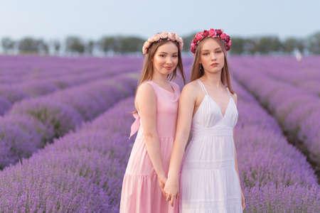 Two women girlfriends posing in lavender field