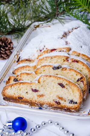 Traditional Christmas Stollen with almonds and dried fruit