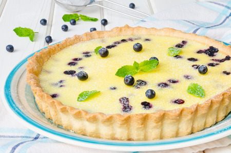 Tart with blueberries in cream filling Stock Photo