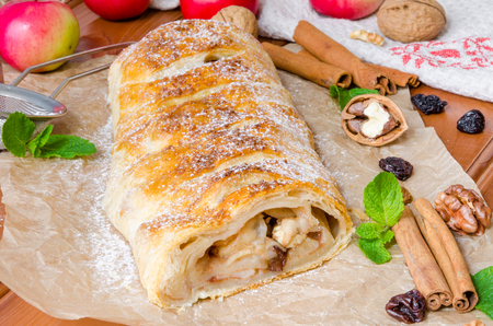 strudel: puff pastry strudel with apples, cinnamon, raisins and walnuts Stock Photo