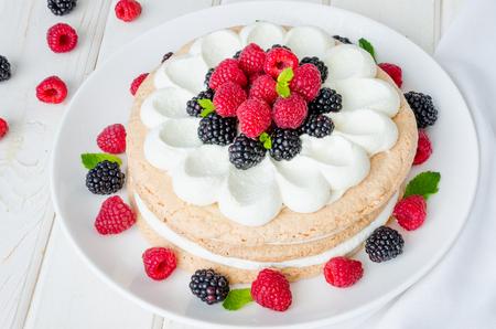 Layer walnut cake with cream and berries