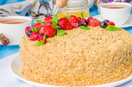 honey cake: Homemade honey cake with sour cream and berries on top Stock Photo