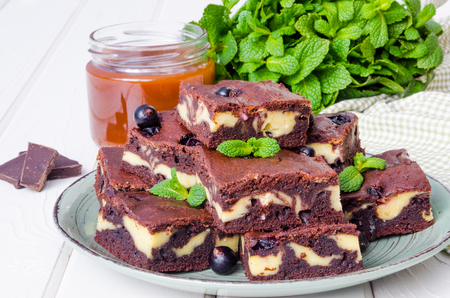 Cheesecake brownies with currants and caramel sauce 写真素材