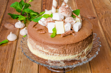 Marble chocolate coffee cheesecake with meringue, marshmallow and chocolate on top