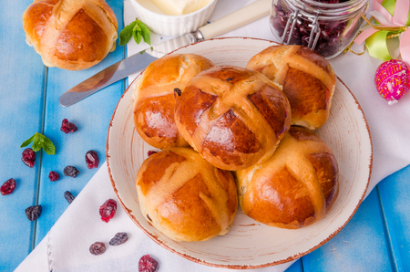 Easter hot cross buns with dried cranberries and raisins
