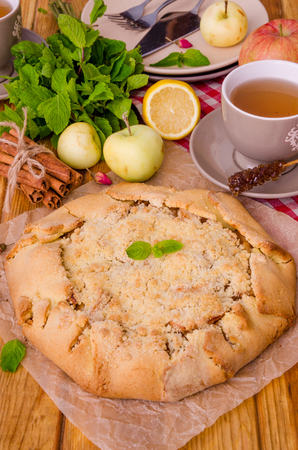 Open pie or galette with apples with cinnamon and crumbs