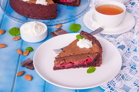 Tart with chocolate cream and cherry