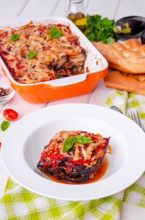 Eggplant casserole with tomato sauce, cheese and fresh basil. Delicious summer stew.