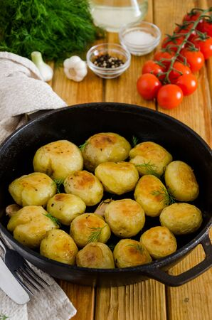 Fried Young Potatoes with garlic and dill. Rustic style.