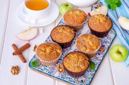 Homemade crispy apple muffins with walnuts and cinnamon