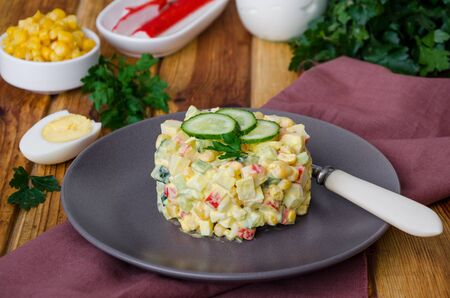 Traditional Russian salad with crab sticks