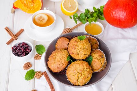 spiced pumpkin muffins with walnuts and cranberries Stok Fotoğraf