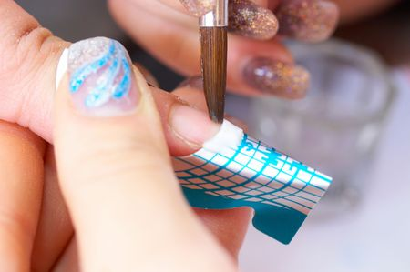 Correction of nails using acrylic  and disposable form. French manicure Stock Photo - 2631419