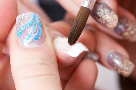 Correction of nails using acrylic . French manicure 写真素材