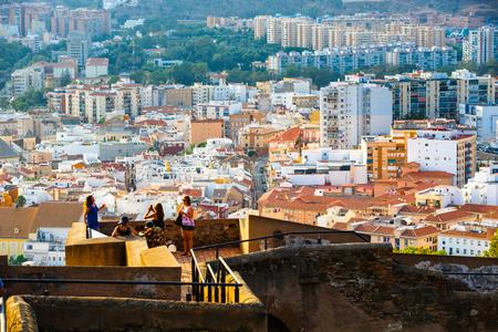 impregnable: Malaga, Spain , September 08, 2015. Walls of courtyard of Castillo de Gibralfaro and view of residential area of Malaga, Costa del Sol, Andalusia, Spain