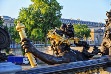 PARIS, FRANCE - MAY 18, 2015: Alexander III bridge in Paris, France, nymph of Seine, the fragment of the central decorative element of the bridge