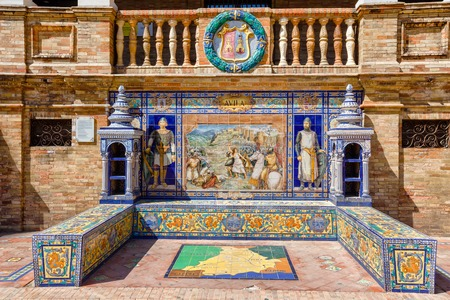 paintings art: Ceramic bench on the Plaza de Espana in Sevilla, with a historic episode of Avila. Was built in 1929 for Ibero-American exhibition. Andalusia, Spain.