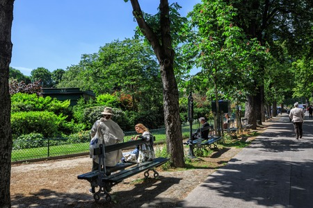 champs elysees: Paris, France - May 18, 2015: People resting on benches of boulevard under trees shadow. Alley near  the Champs Elysees Editorial