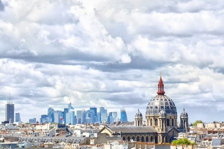 dozens: Paris, France - May 20, 2015: Saint- Augustine Cathedral dome and  La Defense - business center with dozens of skyscrapers and business centers is on the background Editorial