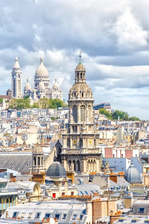 sacred trinity: Paris, France, May 20, 2015. Eglise de la Sainte-Trinite, Holy Trinity Church and  Basilique du Sacre Cour, Basilica of the Sacred Heart on Montmartre