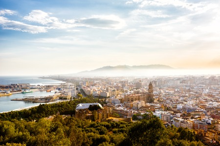 impregnable: Malaga, Spain - September 08, 2015: View of the Santa Iglesia Cathedral Basilica of Lady of Incarnation, port and cityscape of Malaga, Spain