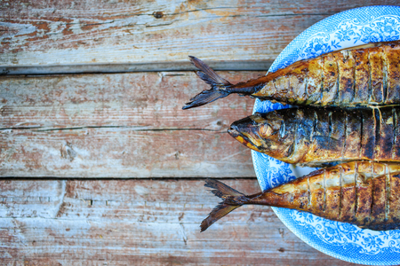 blue fish: Grilled mackerel on the blue plate on wooden table