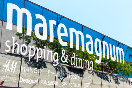 entertainment center: Barcelona, Spain - May 27, 2016: view of mirror signboard of shopping and entertainment center Maremagnum in the Port Vell de Barcelona Editorial