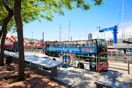 Barcelona, Spain - May 27, 2016: Touristic two-tier bus in Barcelona port, many tourists inside
